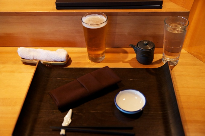 A nice place setting enhanced by a tall glass of draft Sapporo